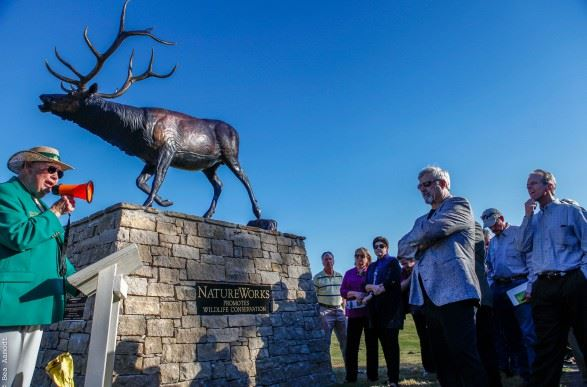 Observers and elk statue